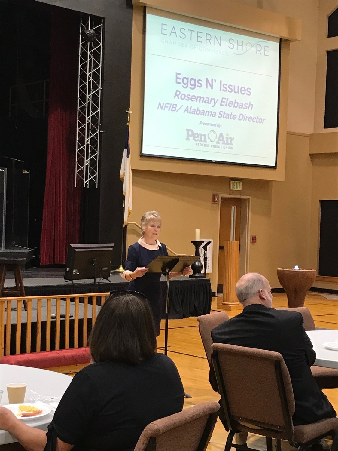 Rosemary Elebash, Alabama director of the National Federation of Independent Businesses, addresses the March Eggs and Issues meeting of the Eastern Shore Chamber of Commerce.