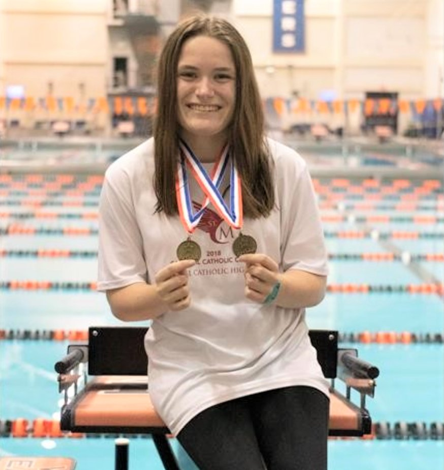 Sarah Kate Sligh displays her AHSAA State Swim Meet Medals.