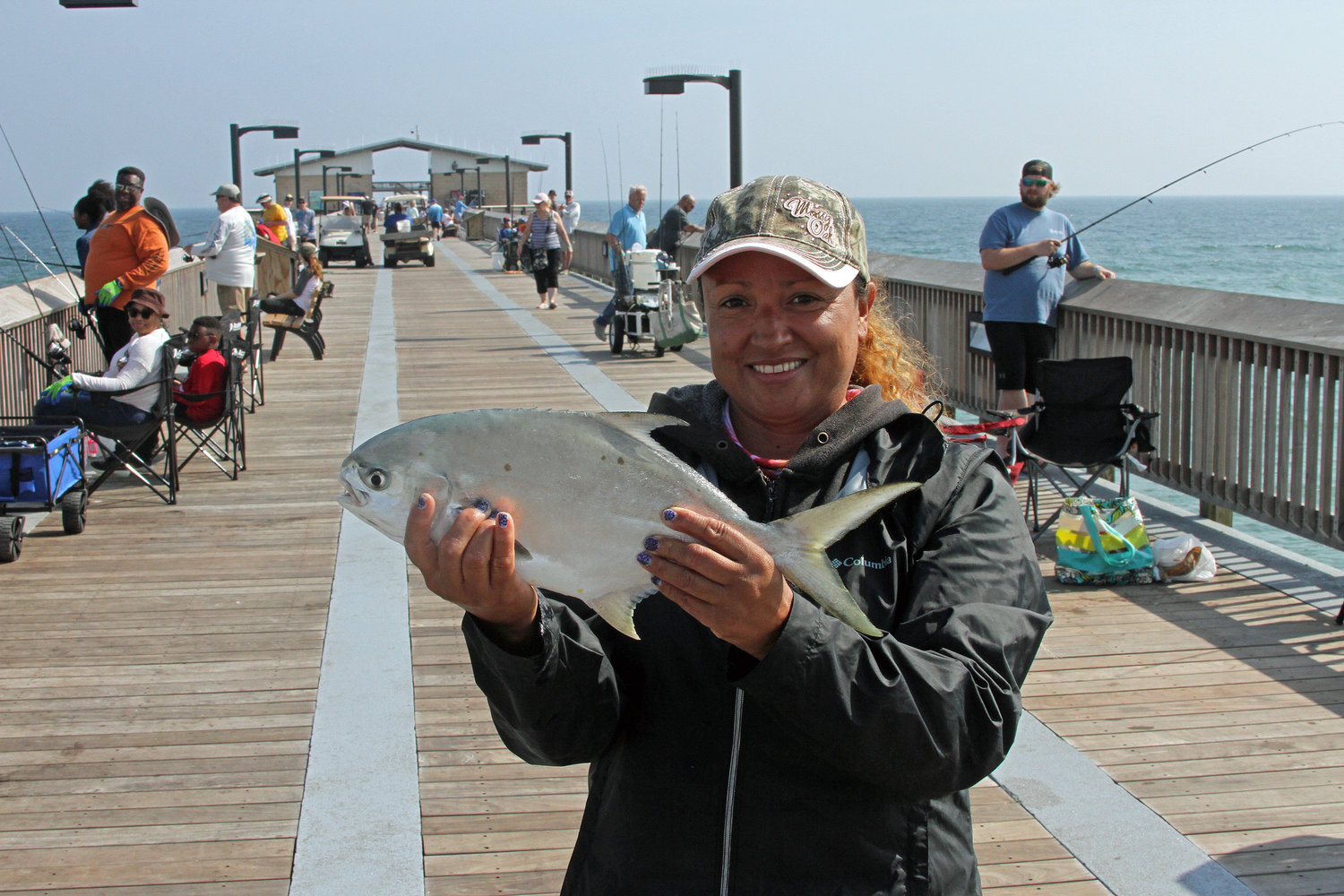 Ramona Meza of Foley shows off a nice Florida pompano caught recently on the Gulf State Park Pier.