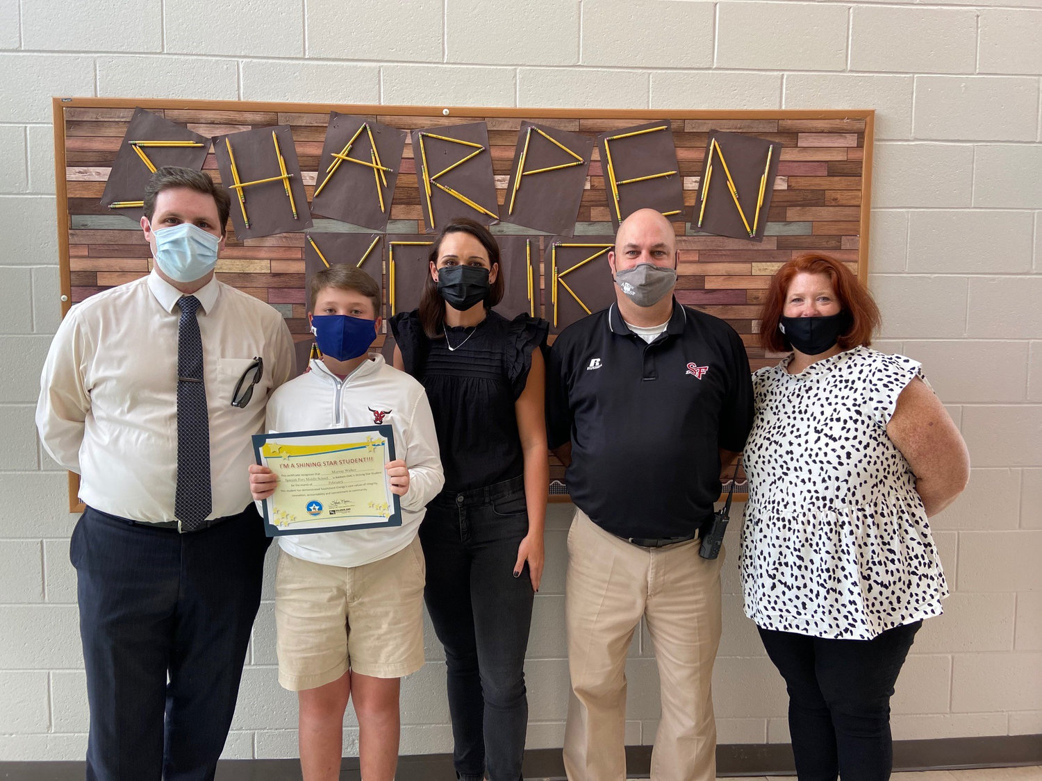 Spanish Fort Middle School student Murray Walker (holding certificate) is pictured with (l-r) FOX 10 TV's meteorologist Michael White, teacher Anna Hunt, Principal Oliver Sinclair, and mother Leigh Walker.