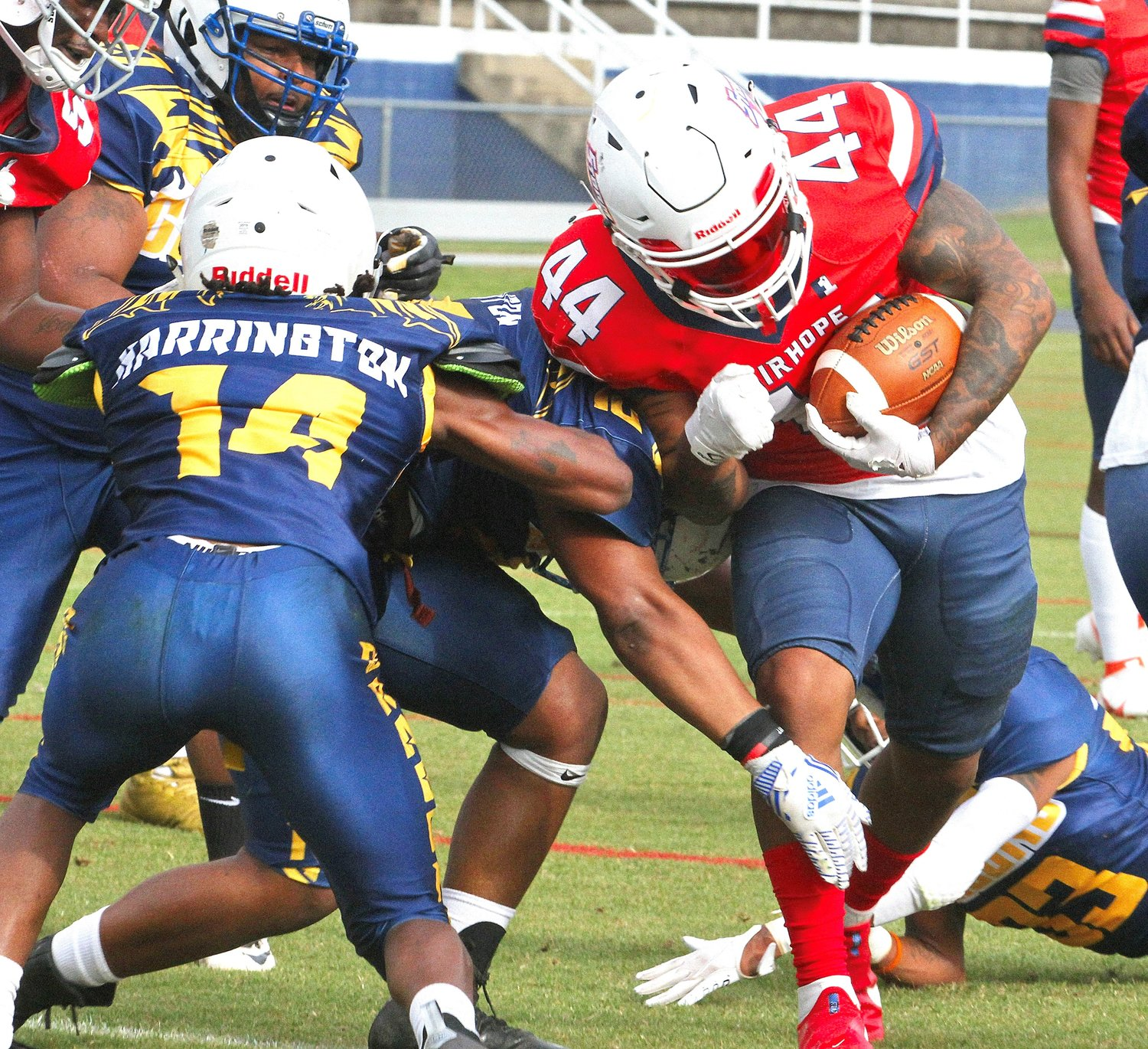 Jamal Vines (44) powers through the Dragons' defense.