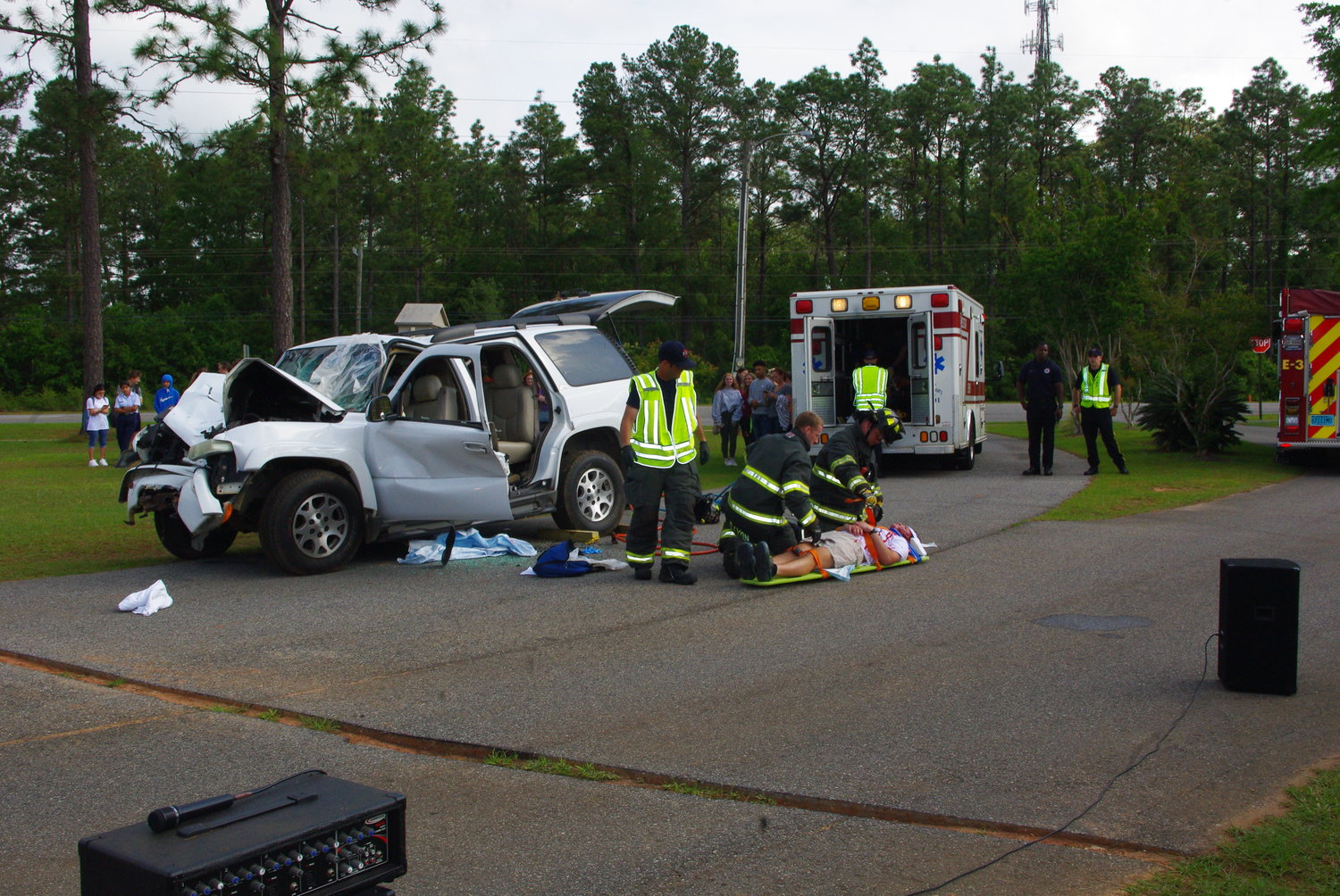 An accident victim removed from a wrecked vehicle waits to be loaded into an ambulance.