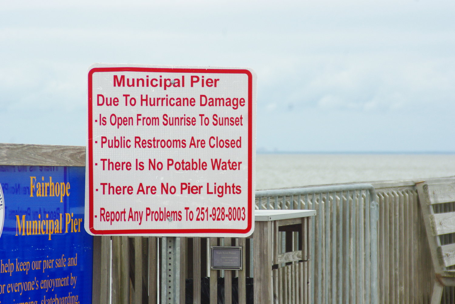 A sign on the Fairhope Pier warns that the facility does not have water, sewer or electrical service since Hurricane Zeta struck in October.
