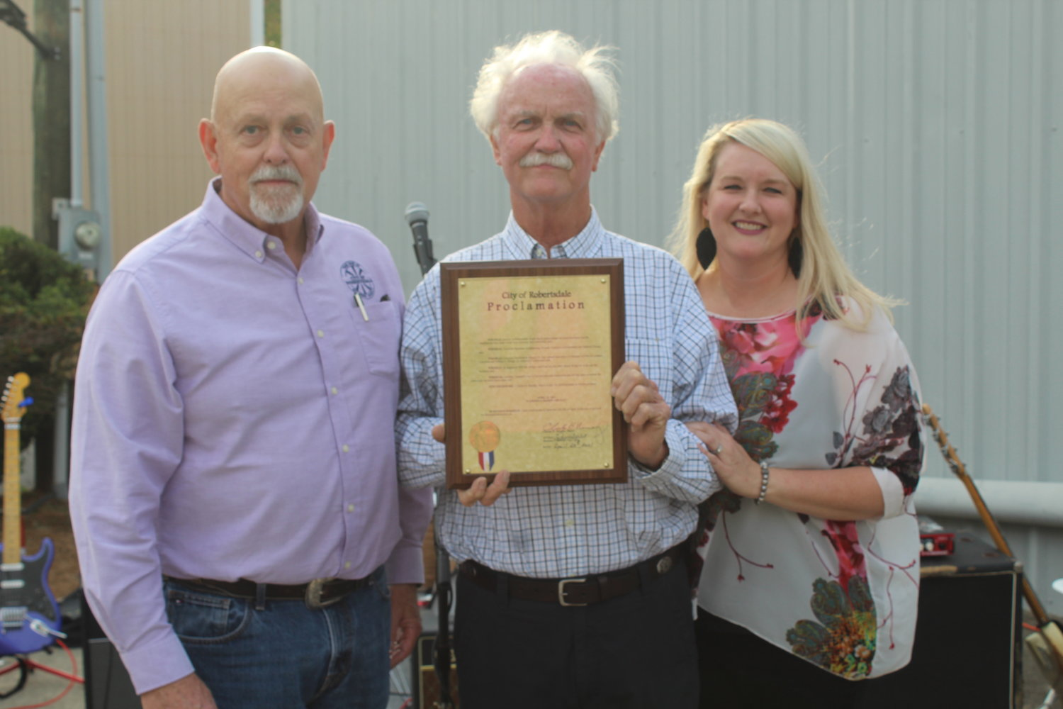 Nelson Wingo and daughter Ashley Kucera receive a proclamation from Robertsdale Mayor Charles Murphy.