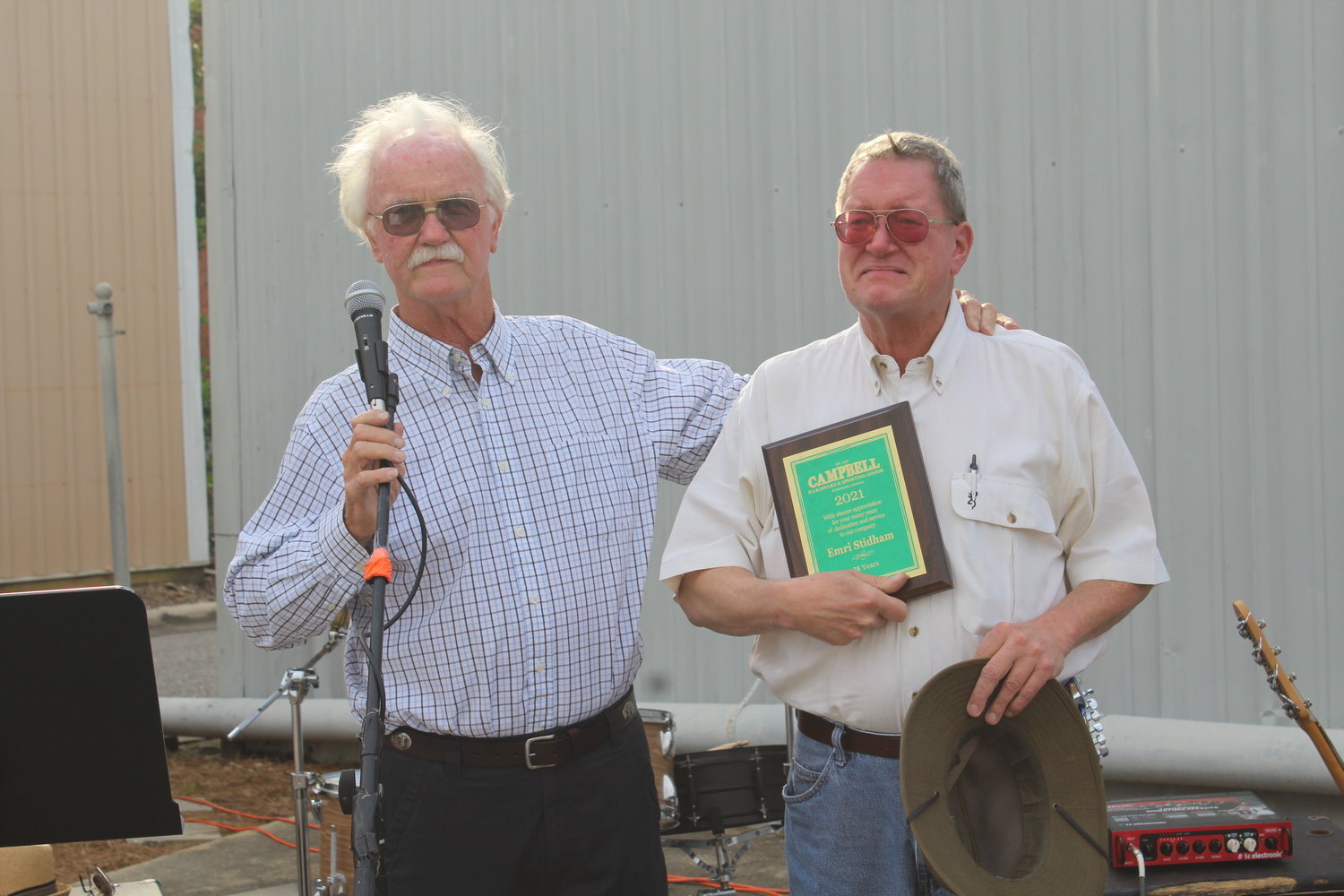 Nelson Wingo presents awards to longtime employee Emory Steadham.
