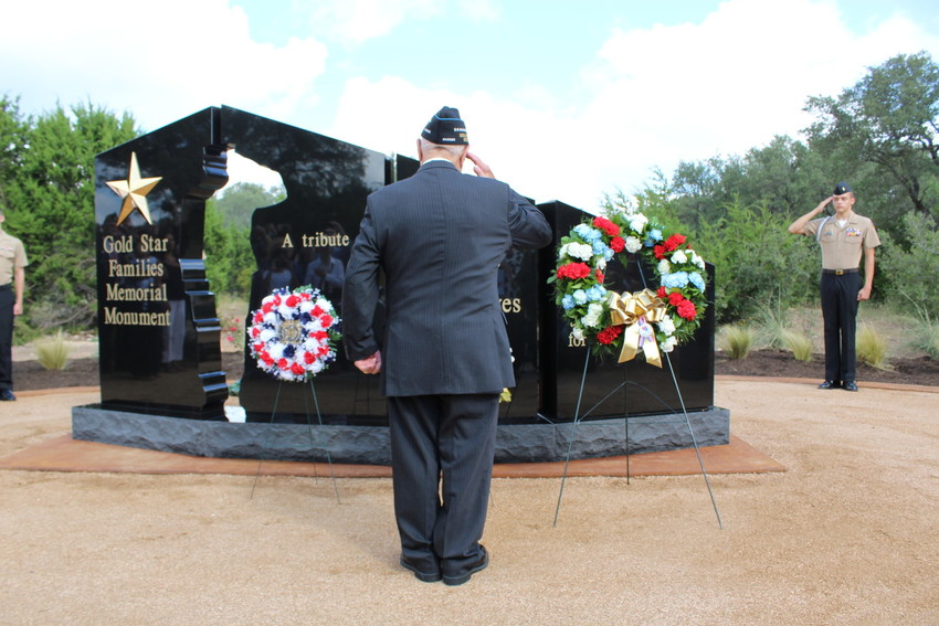 Woody Williams, a WWII veteran and Congressional Medal of Honor recipient salutes the Gold Star Family Monument at Cedar Park Veterands Memorial Park, Saturday, Sept. 23. The monument honors famlies who have lost family members in the U.S. armed forces.