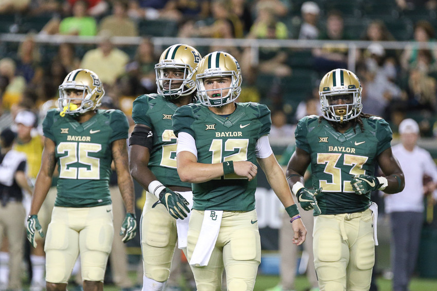 Baylor Bears true freshman quarterback Charlie Brewer (12) takes the field at the start of the fourth quarter of an NCAA football game between the Baylor Bears and the West Virginia Mountaineers at McLane Stadium in Waco, Texas.