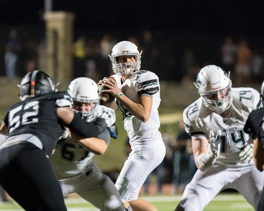 Cedar Park Timberwolves junior Ryan Fiala (16) drops back to pass during a high school football game between Vandegrift and Cedar Park at Monroe Stadium in Austin, Texas on Friday, September 8, 2017.