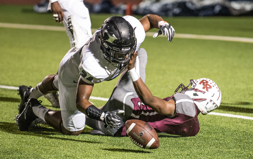Hendrickson Hawks linebacker Cliffton Styles dives for a loose ball during a high school football game between Pflugerville Hendrickson and Round Rock High School at Dragon Stadium in Round Rock, Texas, on November 3, 2017.