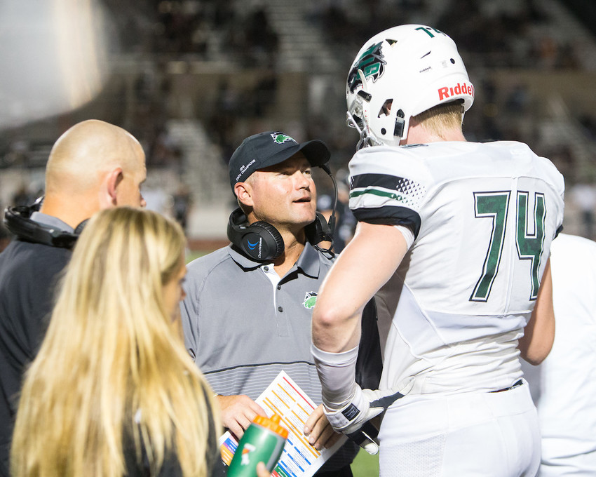 Cedar Park Timberwolves head coach Carl Abseck talks with senior Mason Brooks (74) during a game at Vandegrift on Friday, September 8, 2017. The Timberwolves rebounded from a halftime deficit to beat Magnolia 24-20 in the bi-district playoffs on Friday night.