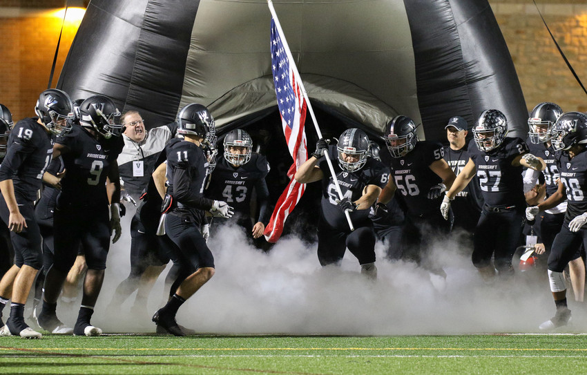 The Vandegrift Vipers take the field for the start of a high school football game between the Vandegrift Vipers and the Lake Travis Cavaliers at Monroe Stadium in Austin, Texas, on November 10, 2017.