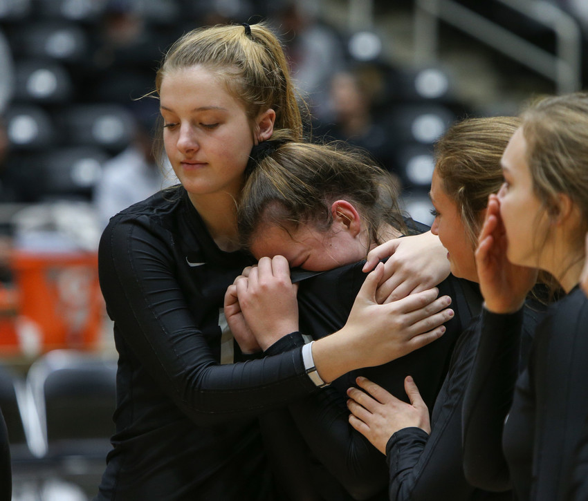 Rouse senior McKenzie Wells (left) consoles Maddie Sheehan after the Raiders lost the Class 5A high school volleyball state final to Prosper High School at Curtis Culwell Center in Garland, Texas, on November 18, 2017. Prosper won the match in five sets, (25-18, 21-25, 18-25, 25, 23, 16-14) to win the 5A state championship.