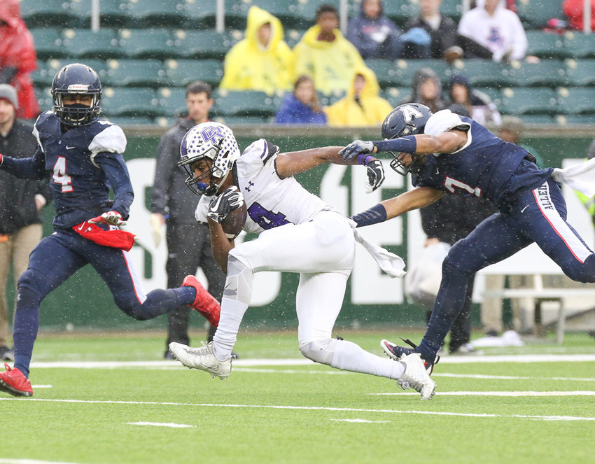 Cedar Ridge Raiders junior wide receiver Jaylen Ellis (4) brings in a deep pass for Cedar Ridge's only touchdown of the game during the Class 6A Division I state semifinal game between Allen High School and Cedar Ridge High School at McLane Stadium in Waco, Texas, on December 16, 2017.