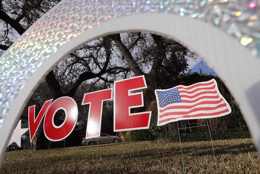 """A """"vote"""" sign in a yard in west Austin on Mar. 6, 2017."""