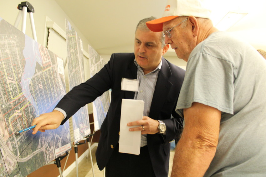 Jay Scanlon discusses with a Cedar Park resident about possible drainage infrastructure projects that could benefit Cedar Park neighborhoods with residents of Riviera Springs during a town hall meeting, Monday Nov. 6.