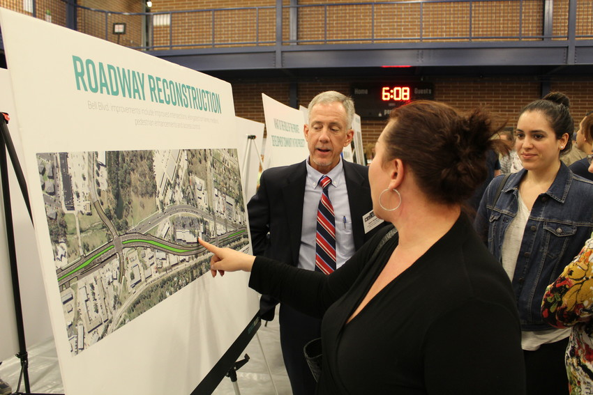 "Cedar Park Asst. City Manager Sam Roberts speaks with a resident during the ""Heart of Bell Boulevard"" community workshop, Nov. 14."