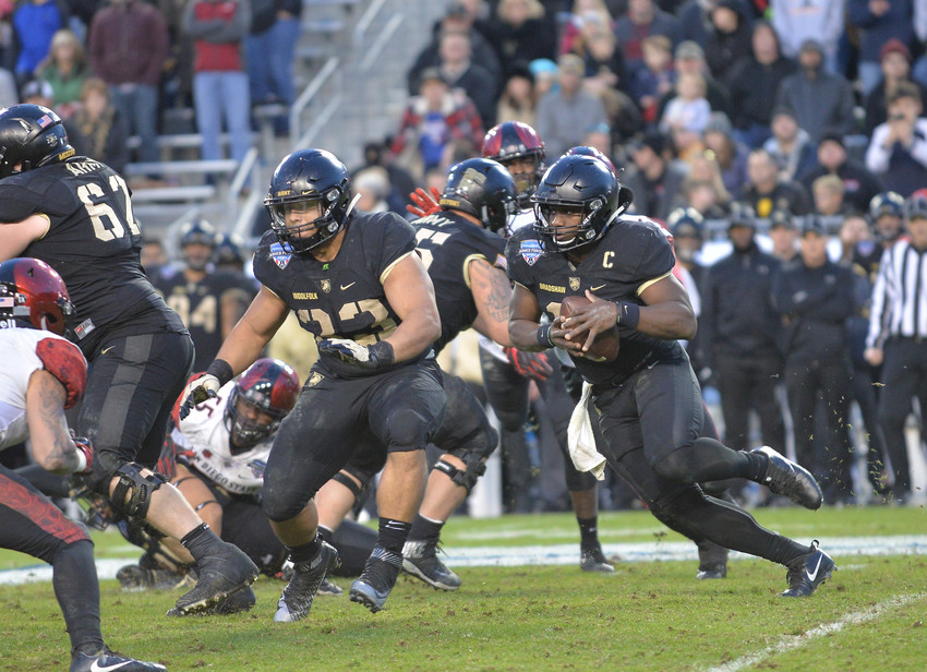 Army quarterback Ahmad Bradshaw ran for 180 yards and two touchdowns as the Black Knights beat San Diego State 42-35 in the Armed Forces Bowl on Dec. 23.