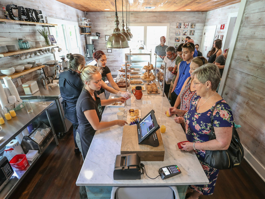 Casa Costa Bake Shop employees rush to serve customers during their grand opening of their store on Bagdad Street in Old Town Leander August 2017.