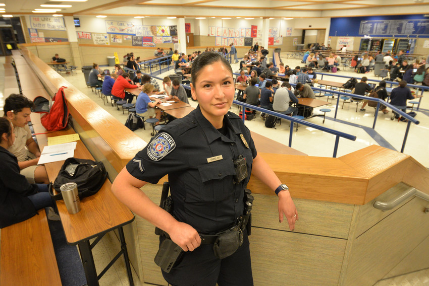 School resource officer Aurora Grimes watches over Leander High School students during study hall.