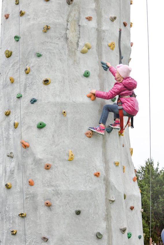 Colder than usual weather couldn't keep this one climber away from the climbing wall at the Cedar Park Festival on Sunday, April seventh. The temperature bottomed out at 37 degrees.