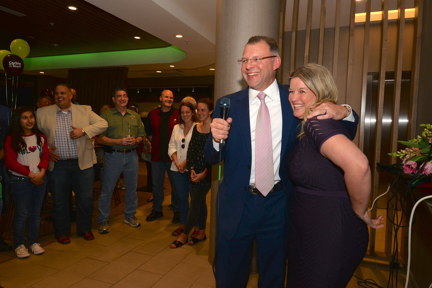 Newly-elected Cedar Park Mayor Corbin Van Arsdale and wife Stephanie celebrate with supporters at Spring Hill Suites in Cedar Park on Saturday night. Van Arsdale secured 70 percent of the vote, beating Bob Cornelius in Saturday's election.