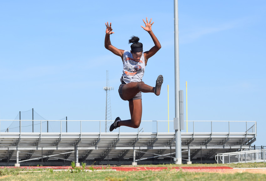 Left: Glenn sophomore Gabby Thomas qualified for the state track and field meet in three events: the long jump, triple jump and 100-meter dash. Right: Leander sophomore Elizabeth Roca broke the school record in the 400-meter dash four times this season and is headed to her first state meet.