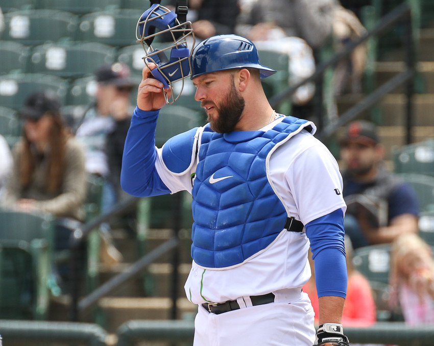 Round Rock Express catcher Cameron Rupp (21) in action during a Minor League Baseball game between the Round Rock Express and the Memphis Redbirds at Dell Diamond on April 8, 2018.