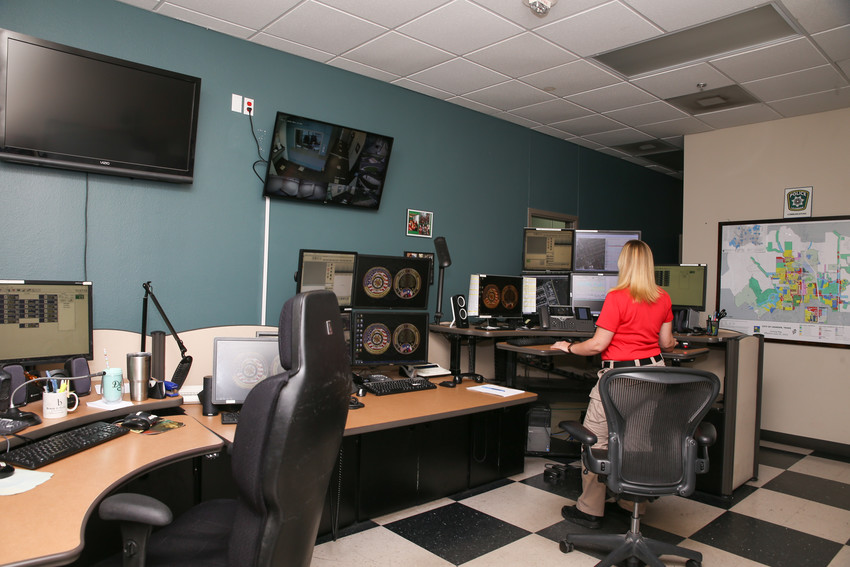A dispatcher views the multiple monitors at a workstation in the Leander Police Department's dispatch center. The Leander City Council gave final approval for a new microwave tower to be built adjacent to the police department to reduce the chances the dispatch center could go offline as a result of inclement weather or power outages.