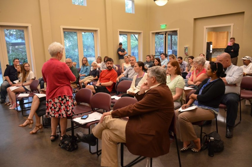 State Rep. Paul Workman (right) and Travis County Commissioner Brigid Shea (standing) spoke to attendees at a May 8 meeting of the Steiner Ranch Neighborhood Association about issues of congestion along RM 620.