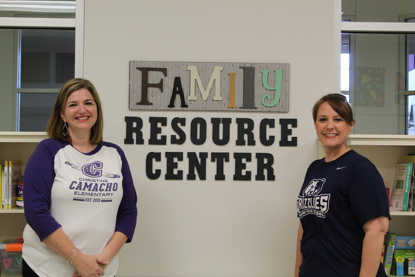 Camacho Elementary Instructional Coach Kristen Phipps (left) and Principal Gena? Fleming show off the school's new Family Resource Center.