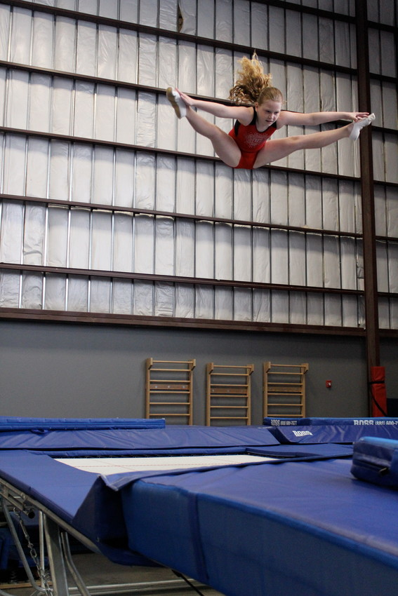 Gymnast Hannah Rodgers, 9, performs a straddle jump during practice at the Tumble Tech facility in Cedar Park.