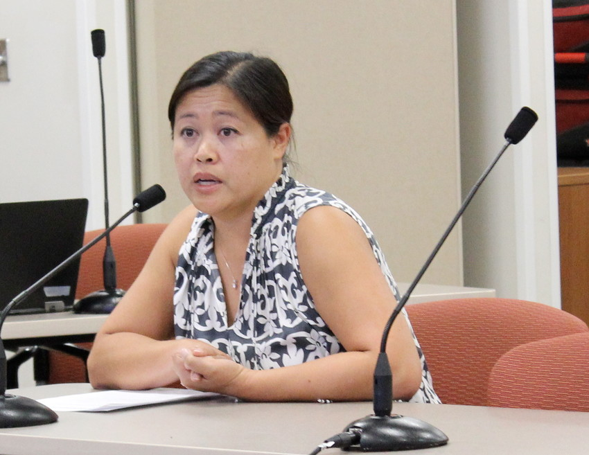 Nicole Tran, parent of a student at Vandegrift High School, addresses the school board about hot buses on Aug. 23.