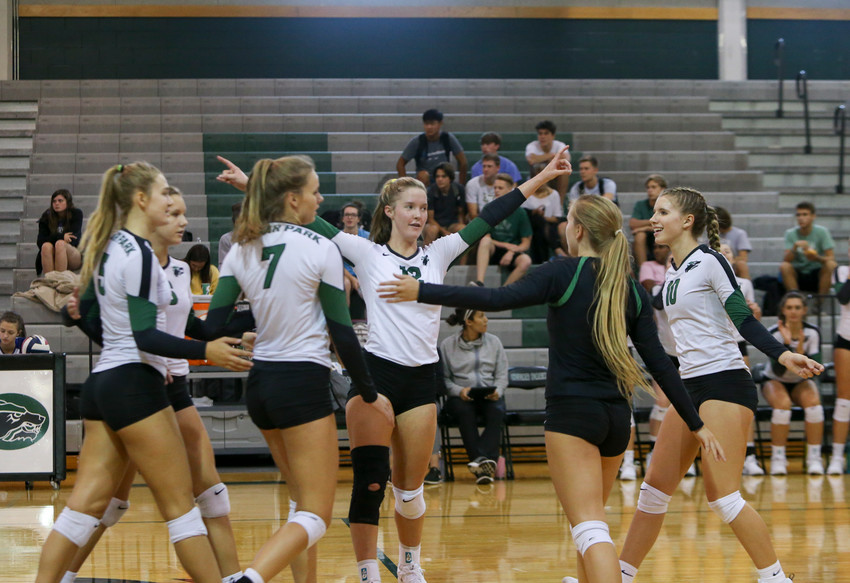 The Cedar Park Timberwolves celebrate a point during a high school volleyball game between Cedar Park and Stony Point High Schools at Cedar Park High School in Cedar Park, Texas, on Aug. 24, 2018.