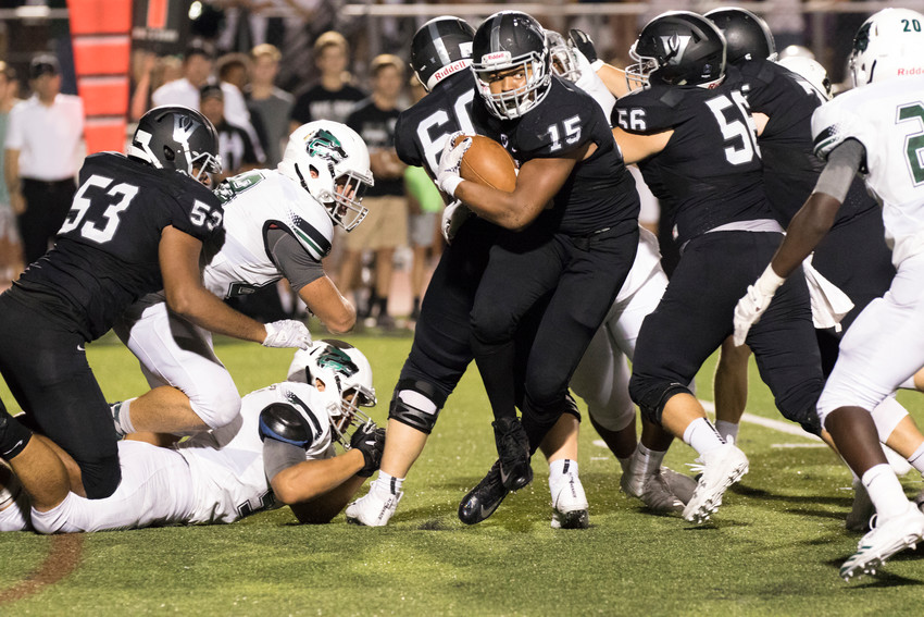 Vandegrift Vipers junior running back Isaiah Smallwood (15) carries the ball during a high school football game between Vandegrift and Cedar Park at Monroe Stadium in Austin, Texas on Friday, September 8, 2017.