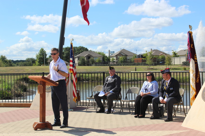 Leander Mayor Troy Hill speaks at the dedication of a new Veterans Park in Leander on Sunday, Sept. 2, 2018.