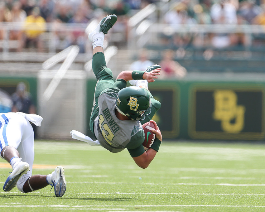 Baylor Bears quarterback Charlie Brewer (12) tumbles after a tackle by Duke Blue Devils safety Dylan Singleton (16)  the ball on a quarterback keeper during an NCAA football game between Baylor and Duke on Saturday, Sept. 15, 2018 in Waco Texas.