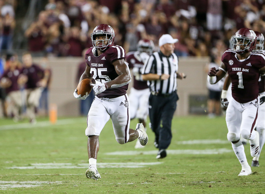 Texas A&M Aggies linebacker Tyrel Dodson (25) looks up to watch himself on the video screen while he returns a blocked ULM field goal attempt for a touchdown during an NCAA football game between Texas A&M and ULM on Saturday, Sept. 15, 2018 in College Station, Texas.