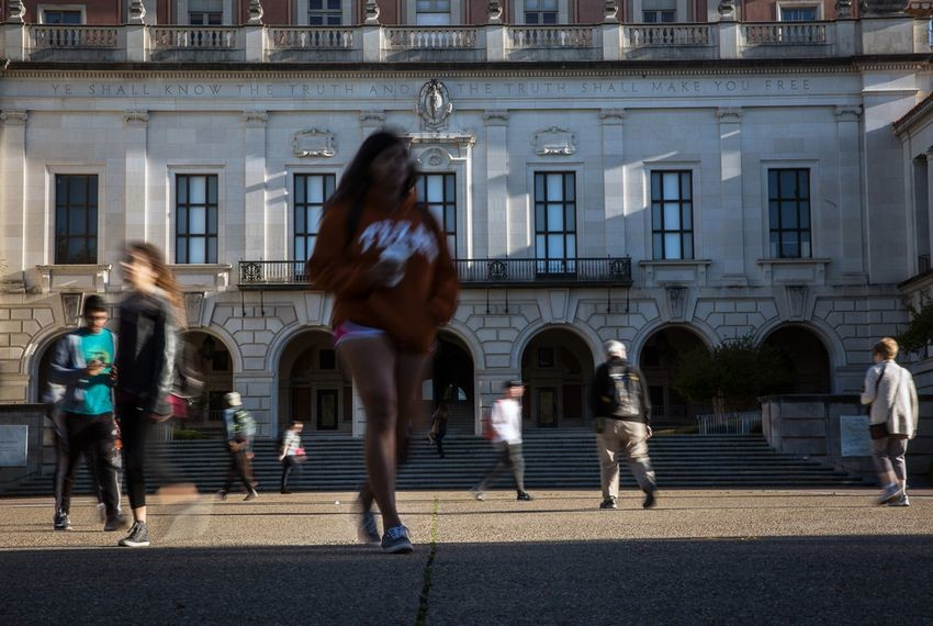 Students walk to class on the campus of the University of Texas at Austin.