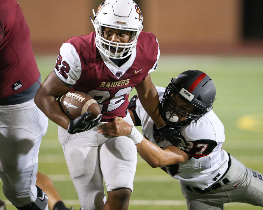 Rouse Raiders junior running back Mylan Mitchell (22) carries the ball during a high school football game between the Rouse Raiders and the Vista Ridge Rangers on Friday, Aug. 31, 2018 in Leander, Texas.