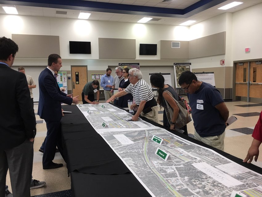 Area residents attend TxDOT's open house to talk about proposed projects to improve congestion and traffic flow on the stretch of Parmer Lane from FM 1431 to SH 45.