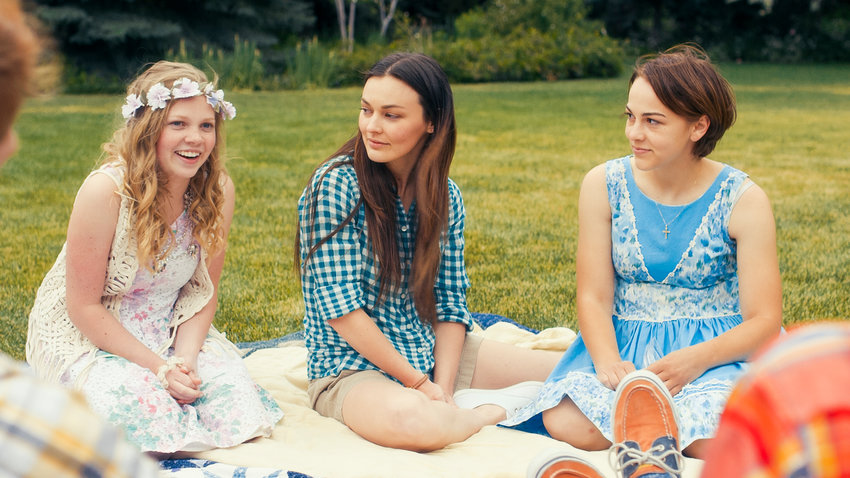 "Elise Jones as Amy, Melanie Stone as Meg and Allie Jennings as Beth in the movie ""Little Women."""