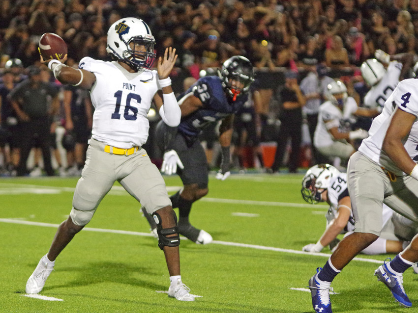 Stony Point High School quarterback Kyle Overton (16) drops back to pass against the Hendrickson Hawks at the Pfield on October 4, 2018.
