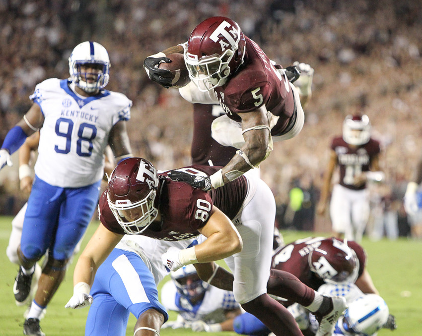 Texas A&M Aggies running back Trayveon Williams (5) dives into the end zone for the game-winning touchdown during overtime of an NCAA football game between Texas A&M and Kentucky on Saturday, Oct. 6, 2018 in College Station, Texas. Texas A&M won, 20-14 in overtime.