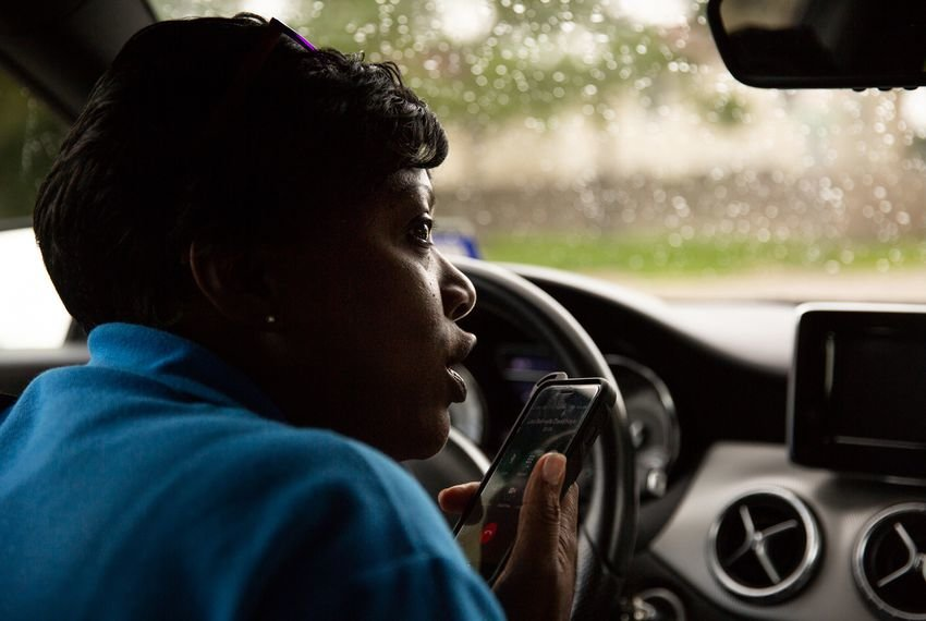 Charla Gilliam, an Adult Protective Services specialist in Houston, calls a client as she's on the way to an in-home checkup in June.