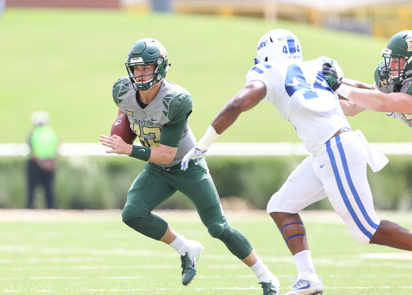 Baylor Bears quarterback Charlie Brewer (12) carries the ball on a quarterback keeper during an NCAA football game between Baylor and Duke on Saturday, Sept. 15, 2018 in Waco Texas.