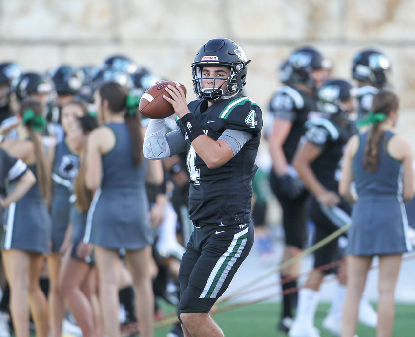 Cedar Park Timberwolves sophomore quarterback Ryder Hernandez (4) warms up before the start of a high school football game between the Cedar Park Timberwolves and the Vandegrift Vipers on Friday, Aug. 31, 2018 in Cedar Park, Texas.