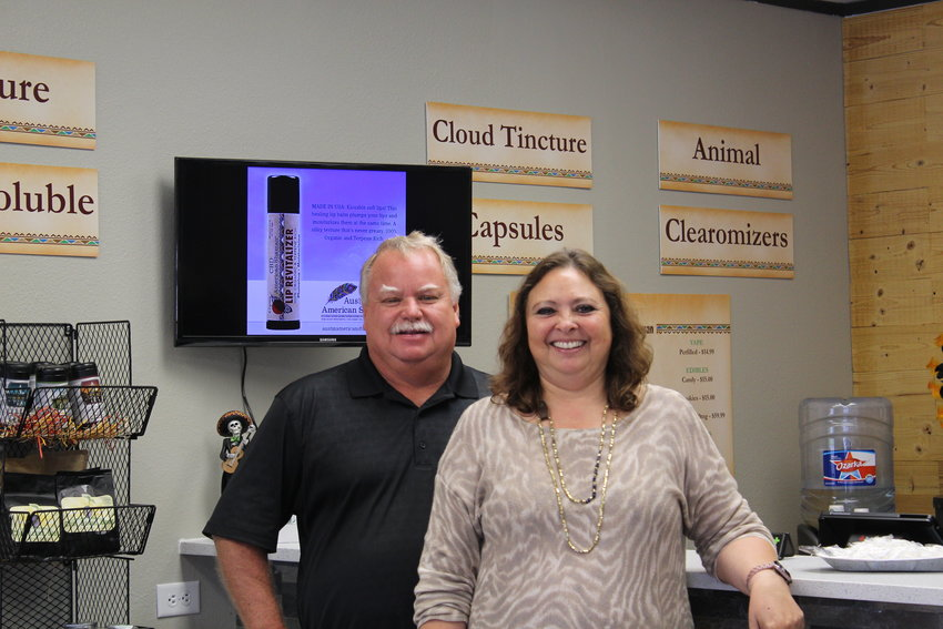 Austin American Shaman owners Gene and Elsie Dietrich stand before their new storefront, which opened in September. The Dietrichs say they are dedicated to helping Austin area customers manage pain through the use of CBD oil.