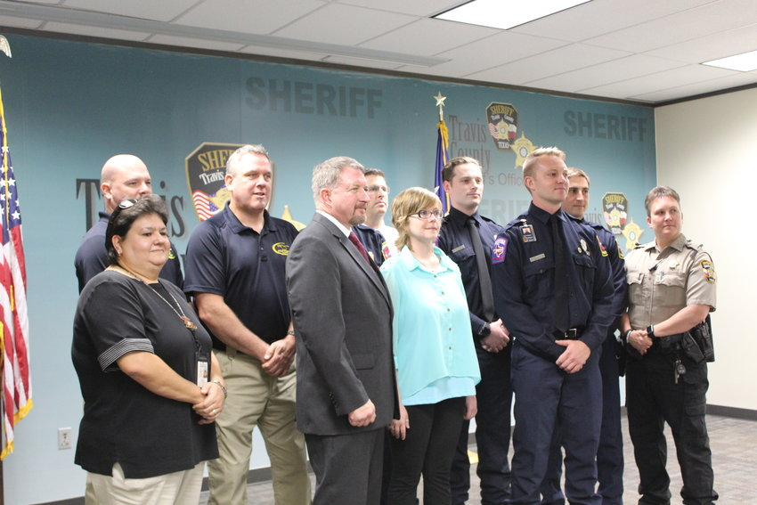 A group of law enforcement officers assembled during a press conference announcing the Justice Served Act, which will provide funding for DNA testing in cold cases, and could also help exonerate individuals wrongly convicted before the widespread use of DNA testing in criminal investigations.
