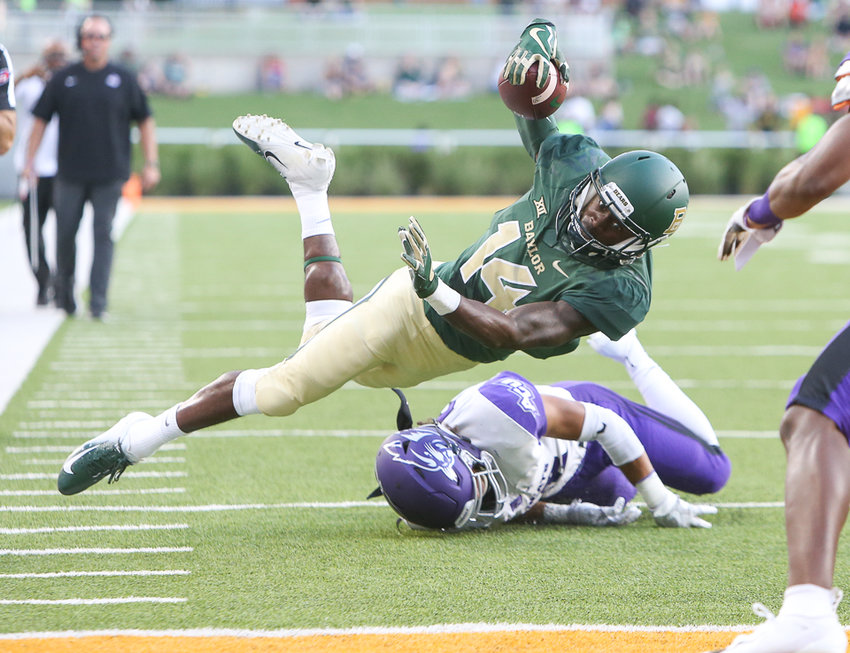 Baylor Bears wide receiver Chris Platt (14) takes to the air on a carry during an NCAA football game between Baylor University and Abilene Christian University on Saturday, Sept 1, 2018 in Waco, Texas.
