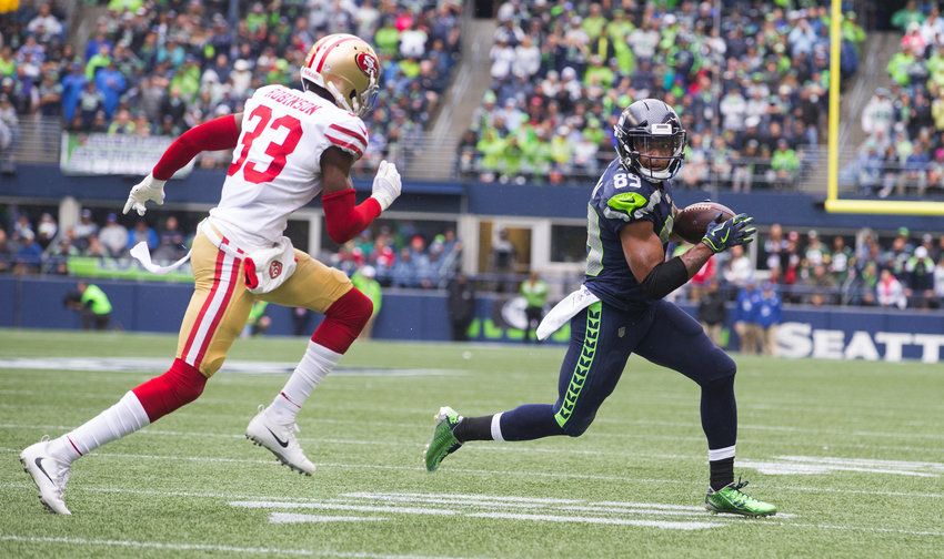 Seattle Seahawks wide receiver Doug Baldwin (89) takes in a Seattle Seahawks quarterback Russell Wilson pass against the San Francisco 49ers on Sunday, Sept. 17, 2017 at CenturyLink Field in Seattle, Wash.